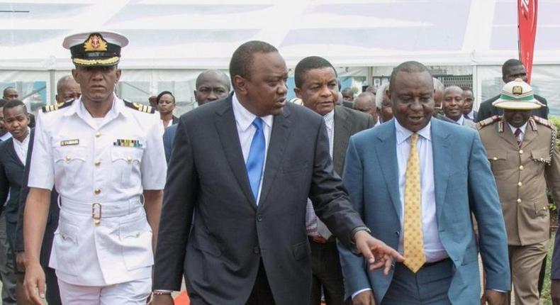 President Uhuru Kenyatta with Finance CS Henry Rotich