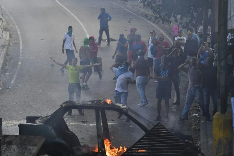 More than 30 small protests broke out around Venezuela's capital Caracas on January 21, 2018 after a failed mutiny by a group of soldiers