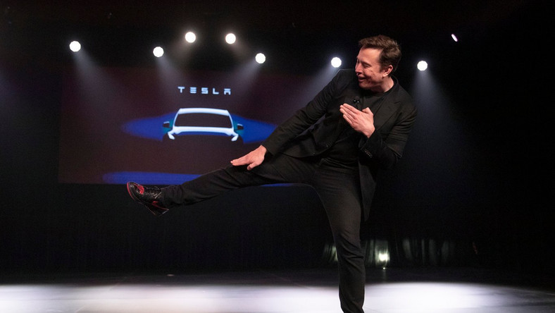 Elon Musk kick shoes Tesla smaller