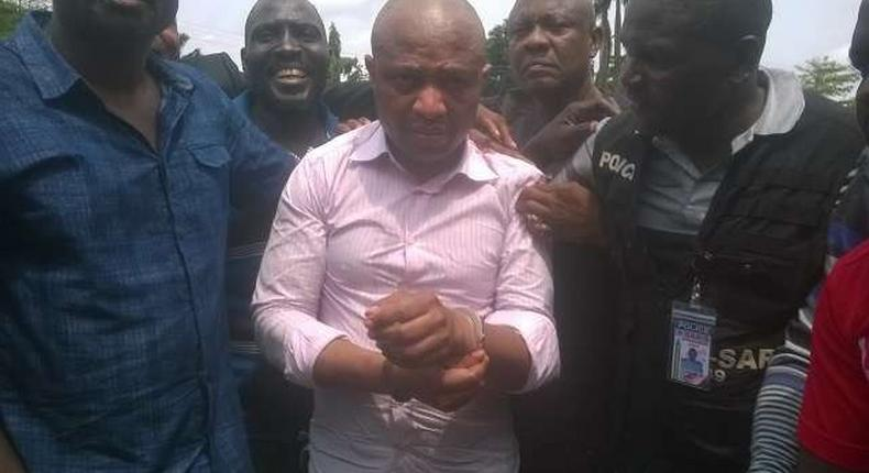 Evans flanked by security operatives