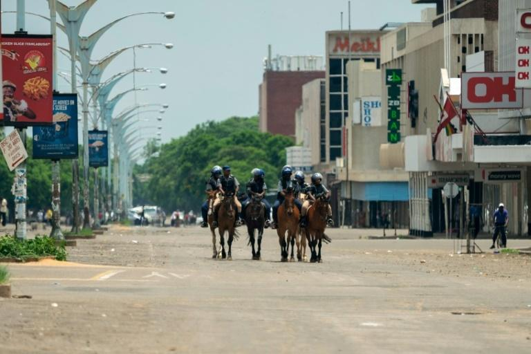 Mounted police patrol Zimbabdwe's second city Bulawayo as shops and offices remain closed for business in the central business district following violent protests triggered by a sharp, sudden rise in fuel prices.