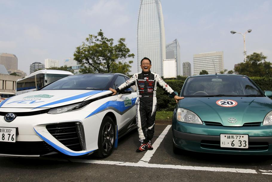 Toyota Motor Corp President Toyoda poses with the company's hydrogen fuel cell vehicle (FCV) sedan c