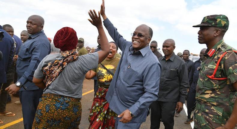 Tanzanian President John Magufuli with his aide in Kongwa District.