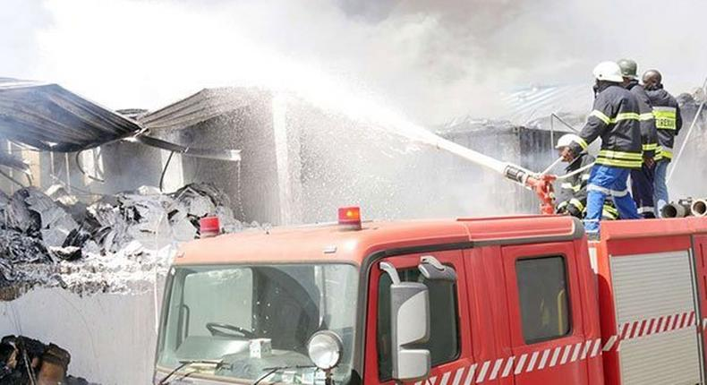 Firefighters at Metro Plastics Kenya Ltd in Industrial Area, Nairobi on March 14, 2020. Police are investigating claims that employees at the factory were allegedly locked up overnight by the employer