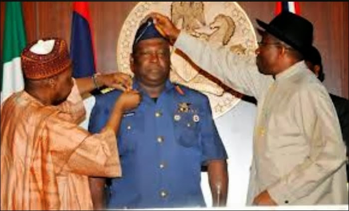 Goodluck Jonathan decorates Air Marshal Alex Sabundu Badeh as Chief of Defence Officer in 2014