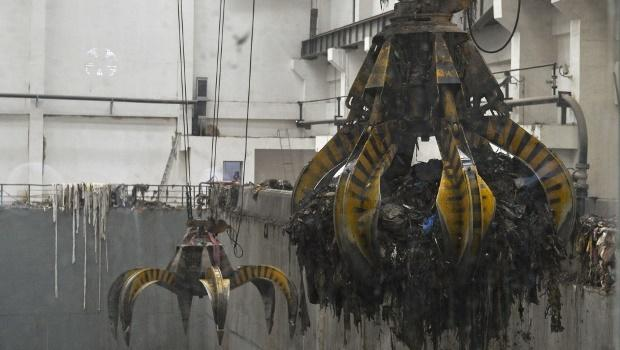 Machinery claws transporting waste in the Reppie Waste-to-Energy Power Project plant in Addis Ababa, Ethiopia.