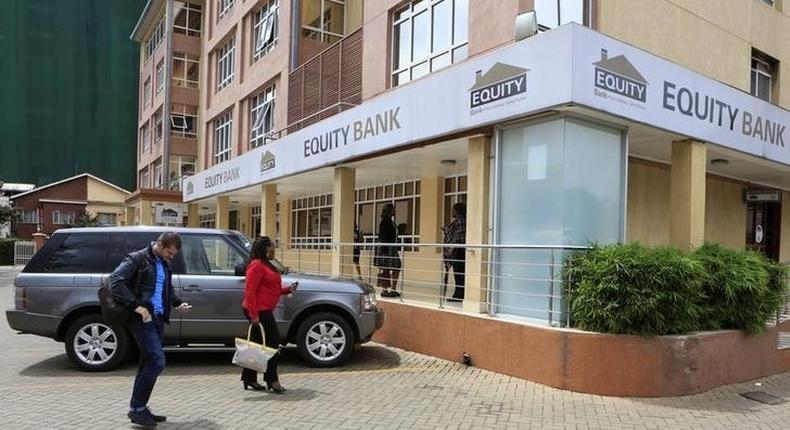 Customers arrive at a branch of the Equity Bank for money transactions in Kenya's capital Nairobi November 11, 2015.