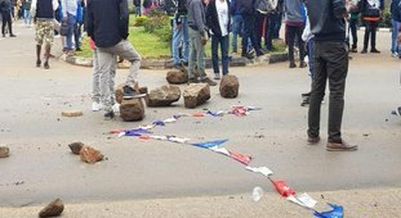 Multimedia University students engage police in running battles
