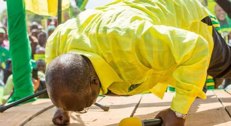 Tanzanian President John Magufuli doing press ups to prove he is physically fit for office during a past event.