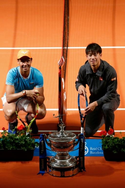 Spain's Rafael Nadal poses with Japan's Kei Nishikori at the Palau de la Musica ahead of the Barcelona Open