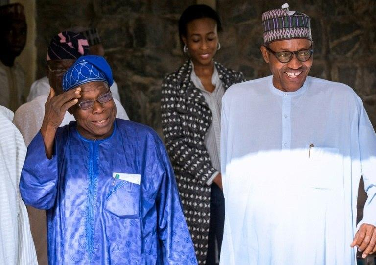 Happier times: Obasanjo, left, chats with Buhari, then president-elect, after the 2015 elections (The Nation)
