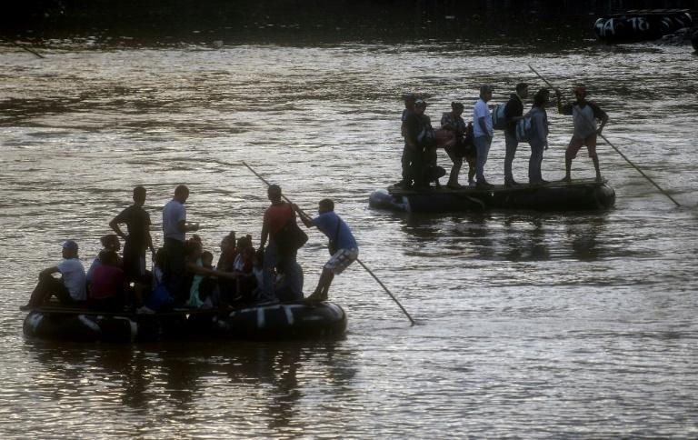 Migrants are using makeshift rafts to illegally cross the Suchiate river, between Mexico and Guatemala