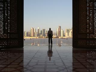Man stands at Imam Muhammad ibn Abd al-Wahhab Mosque in Doha