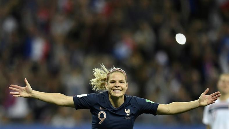 Eugenie Le Sommer celebrates her decisive penalty for France
