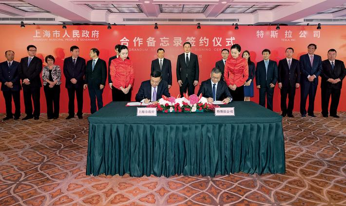 Tesla Inc Chief Executive OfficerElonMusk and Shanghai Mayor Ying Yong attend a signing ceremony in