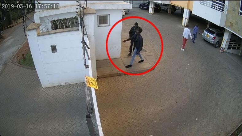 Man hunt for foreigner captured on video threatening to shoot security guard