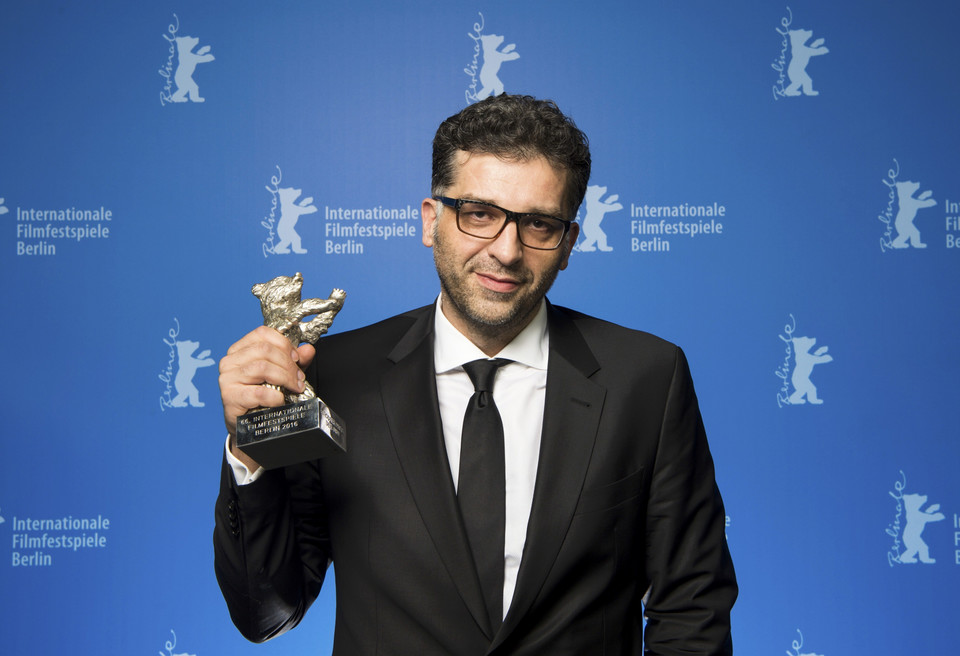 Director Danis Tanovic poses with Silver Bear award, the Jury Grand Prix during awards ceremony of 66th Berlinale International Film Festival in Berlin