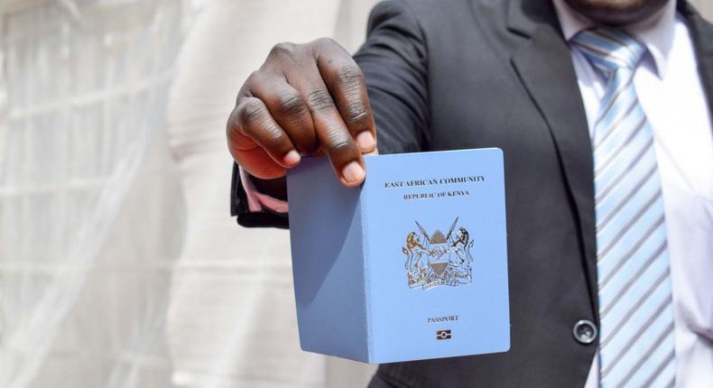 A man showing his Kenyan passport. Immigration Department suspends passport services for unscheduled system maintenance