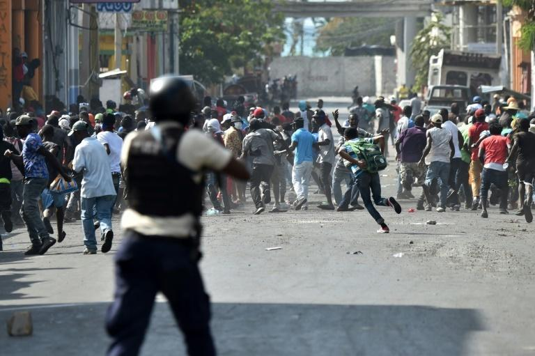 Protesters flee as police open fire during protests in the Haitian capital Port-au-Prince