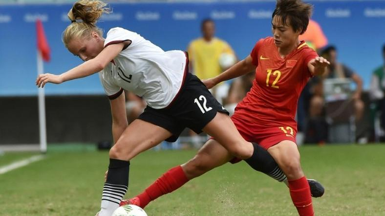 Tabea Kemme (left) of Germany clashes with China's Shuang Wang during their Rio 2016 Olympic women's quarter-final in Salvador, Brazil, on August 12, 2016