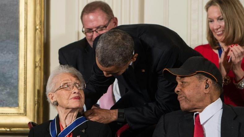 Katherine Johnson, seen here receiving the Presidential Medal of Freedom from Barack Obama, provided pivotal contributions to American space flight research alongside Dorothy Vaughan and Mary Jackson