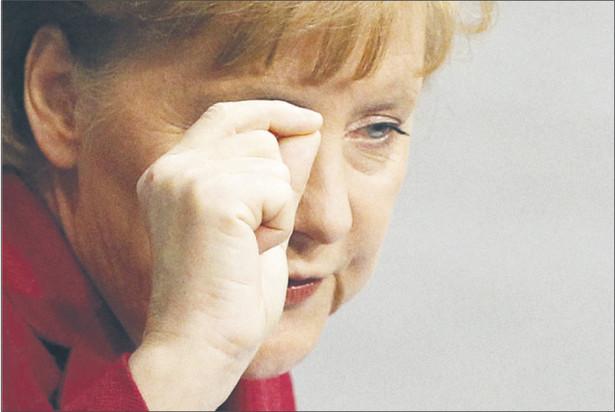 Merkel chce, aby banki uczestniczyły w ratowaniu Aten Fot. Reuters/Forum