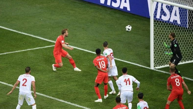 Harry Kane (2L) got England out of jail with an injury-time winner to ensure his side claimed all three points from their opening Group G game against Tunisia