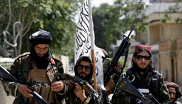Taliban fighters display their flag on patrol in Kabul, Afghanistan, on Thursday, Aug. 19, 2021.