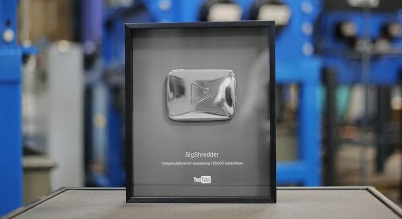 Ten Kenyan celebrities with the YouTube silver plaque.