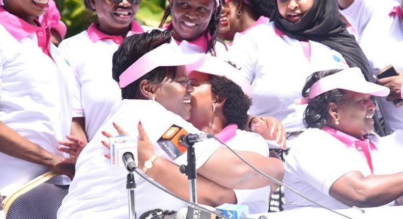 Kirinyaga Governor Anne Waiguru embraces Homa Bay Woman Rep Gladys Wanga during launch of Women for Building Bridges in Kenya initiative (Twitter)