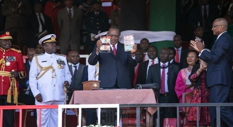 Preident Uhuru Kenyatta with CBK Governor Patrick Njoroge during the launch of new bank notes in Narok