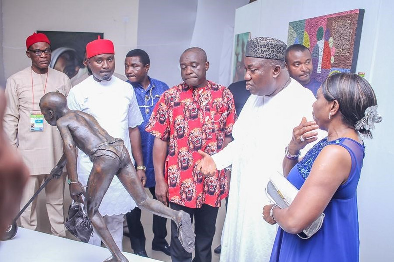 Photo Caption: Enugu State Governor, His Excellency, Ifeanyi Ugwuanyi inspecting some of the art exhibits on display at the Life in My City Art Festival held recently in Enugu.