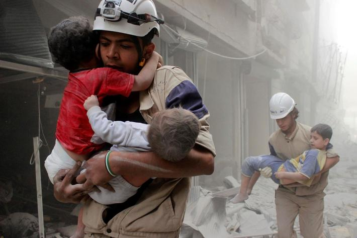 Members of the Civil Defence rescue children after what activists said was an air strike by forces l