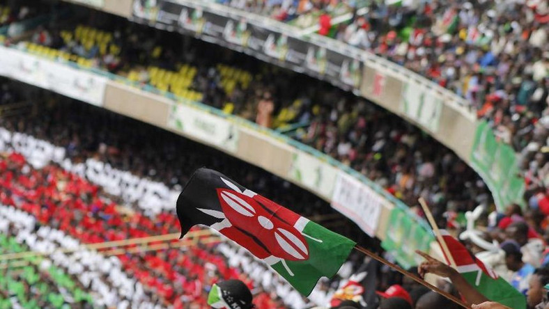 Patriotic Kenyans waving Kenyan flags
