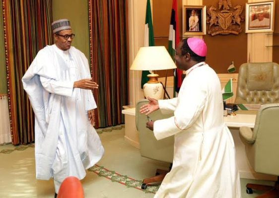 President Muhammadu Buhari meets with Reverend Matthew Kukah on August 27, 2015. Kukah also criticizes the president with regularity (Presidency)