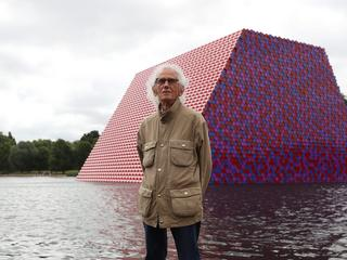 Artist Christo stands in front of his work The London Mastaba, on the Serpentine in Hyde Park, Londo