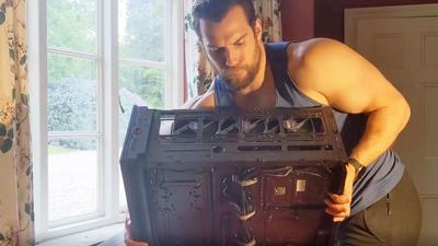 Watch Henry Cavill (and His Massive Arms) Assemble a New Gaming PC