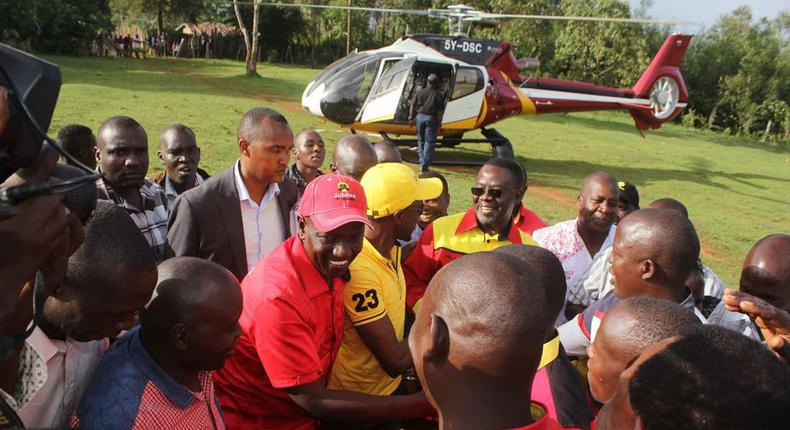 File image of Deputy President William Ruto (centre), and Labour Party of Kenya Leader Ababu Namwamba after alighting from a chopper