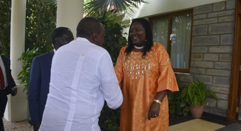 President Kenyatta is received by Mr Odinga and Mrs Ida Odinga at Bondo, Siaya