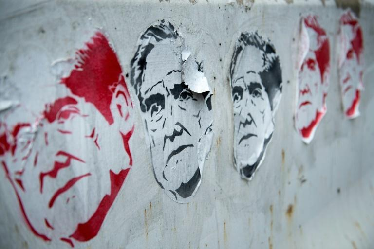 Street art of Special Counsel Robert Mueller, who led the investigation of President Donald Trump and Russian election meddling, outside a construction site in Washington ahead of his testimony in Congress