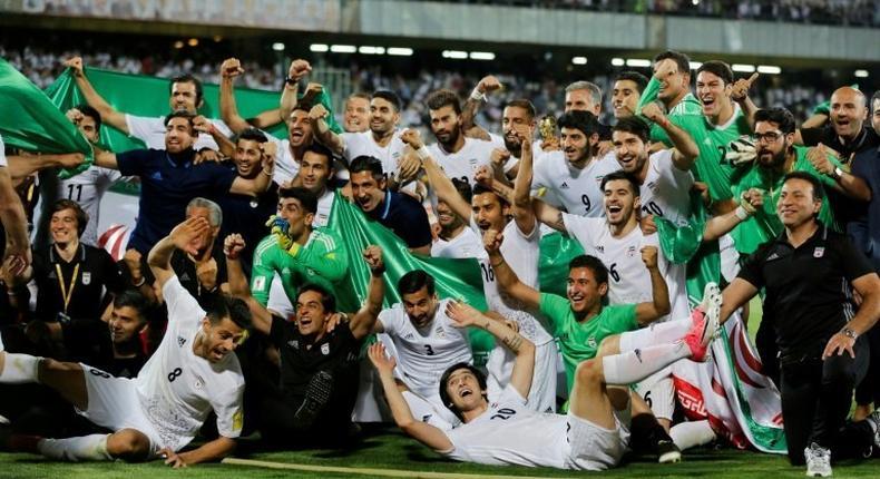 Iranian players celebrate after winning the 2018 World Cup qualifying football match between Iran and Uzbekistan on June 12, 2017