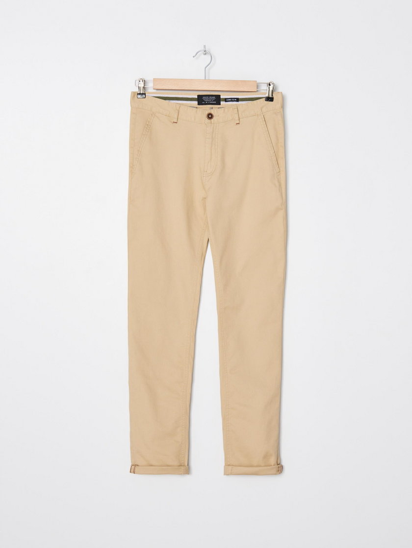 Beżowe spodnie typu chinos