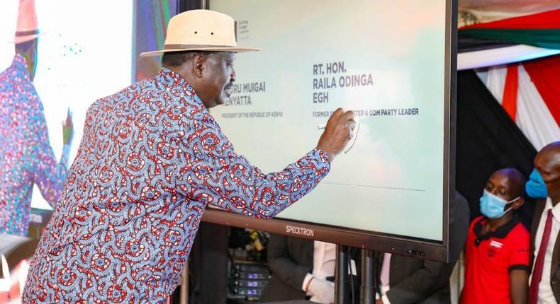 Former Prime Minister Raila Odinga signing the BBI constitutional amendment bill