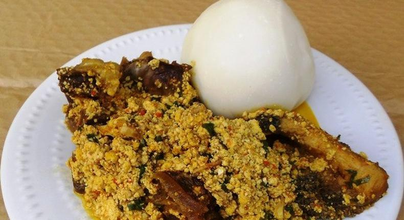 Egusi soup served in a white bowl