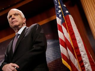 Senator John McCain (R-AZ) looks on during a press conference about his resistance to the so-called