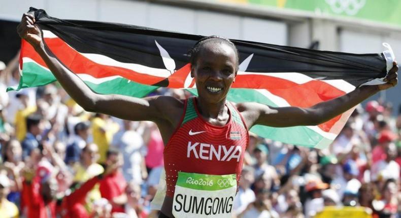 Jemima Jelagat Sumgong of Kenya celebrates after winning the women's marathon race at the 2016 Olympic Games in Rio de Janeiro, Brazil.