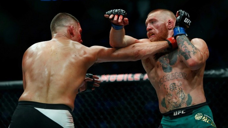 Las Vegas-based Ultimate Fighting Championship (UFC) has shot to sporting prominence by making global stars of fighters such as Conor McGregor (pictured R) and Ronda Rousey