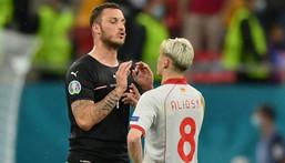 Austria's Marko Arnautovic (left) confronts North Macedonia defender Ezgjan Alioski in the Bucharest match on Sunday Creator: Justin Setterfield