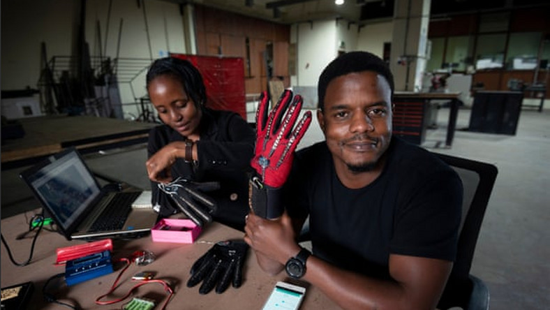 Roy Allela tries out his smart gloves