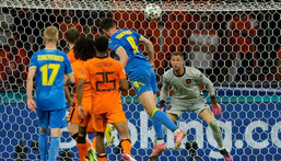 Ukraine looked set to leave with a draw when Roman Yaremchuk (C) equalised late on Creator: Peter Dejong